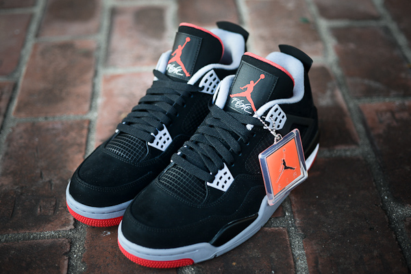 Air-Jordan-4-black-cement-bred-black-fire-red-white.jpg